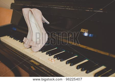 beautiful beige shoes from bride on the piano