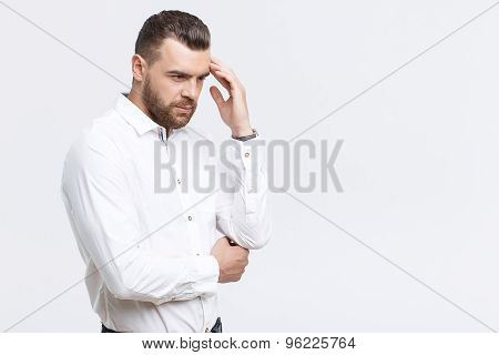 Portrait of man thinking hard