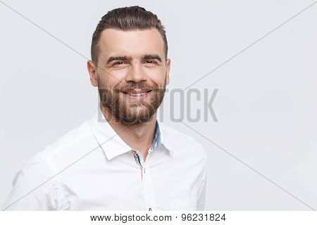 Close-up of smiling man on isolated background