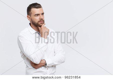 Portrait of thinking man on isolated background