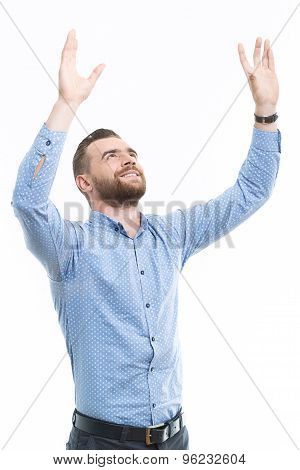 Cheering man with raised arms