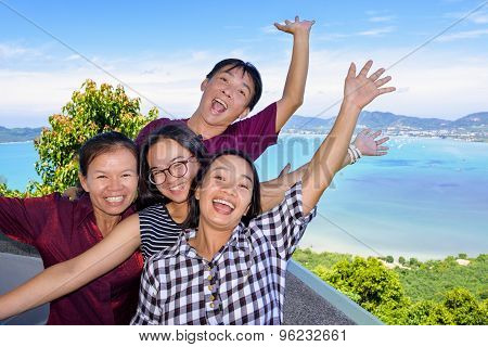 Family Of Tourists Inviting To See The Sea In Phuket, Thailand