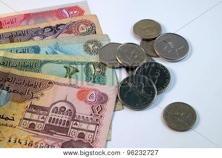 Close up of  Various currency notes and coins from United Arab Emirates