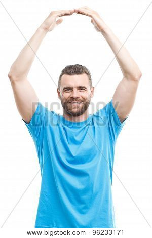 Smiling man holding arms above his head