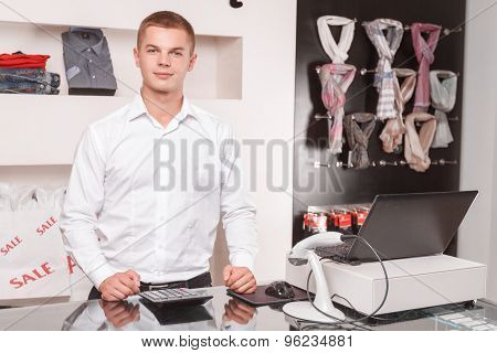 Young male sales assistant at work