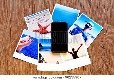 high-angle shot of a smartphone and some photos, shot by myself, of a young man in the beach and some other beach scenes, placed on a rustic wooden table