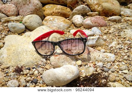Sun Glasses On The Stone