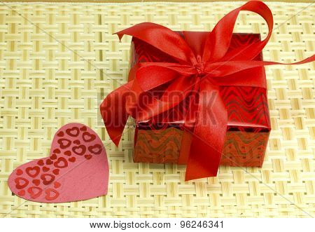 Gift And Hearts On A Wicker Wood