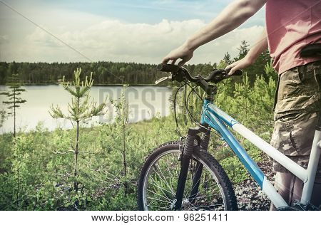 Cyclist On The Background Of Forest Lake