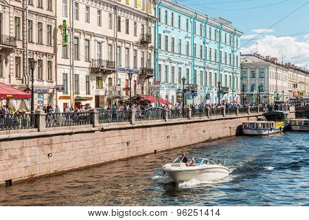 Tourists Walk Along The Canal Griboyedov