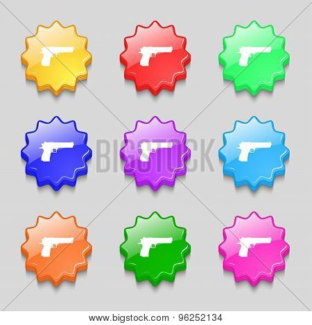 Gun Icon Sign. Symbol On Nine Wavy Colourful Buttons. Vector