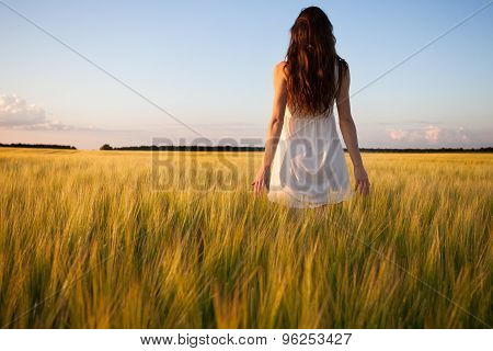 Woman Touching Wheat Ear In Wheat Field