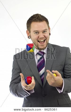 Happy Juggling Businessman
