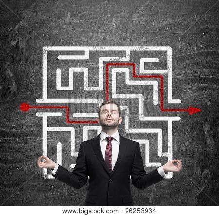 Meditative Businessman And Solved Labyrinth With A Red Arrow On The Black Chalk Board.