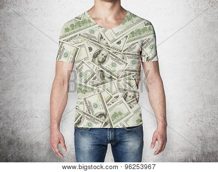 Close-up Of A Man In A T-shirt Crafted From Dollar Notes. Concrete Background.