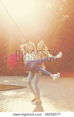 Best Friends. Girl Is Holding Girlfriend.