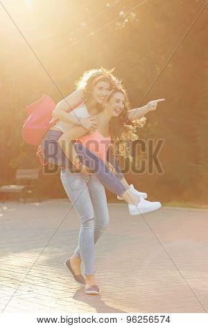Best Friends. Girls Carry Piggyback.