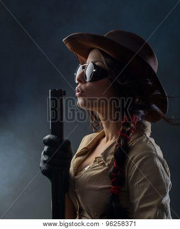 Beautiful cowgirl with gun