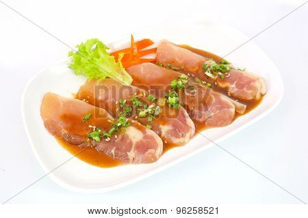 Fresh Slices Of Chicken Isoloate On White Background Ready To Be Grilled.