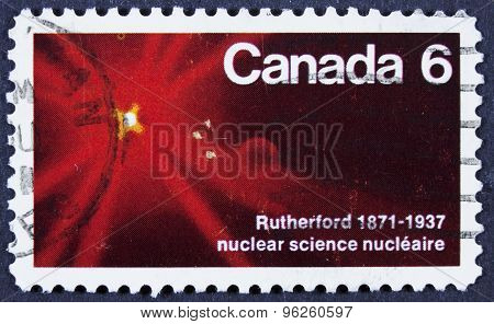 Postage stamp from canada isolated on black.