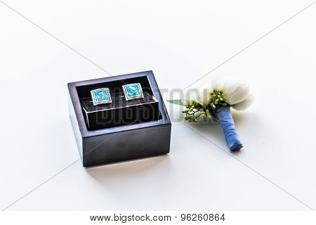 cufflinks and boutonniere