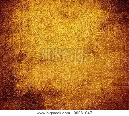 Grunge background of dark tangerine leather texture