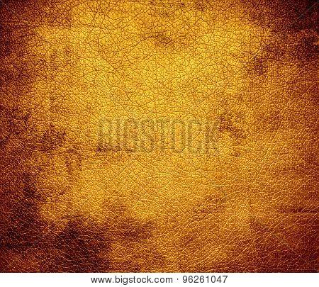 Grunge background of dark tangerine leather texture