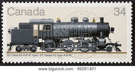 Steam locomotive on a postage stamp.