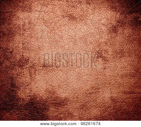 Grunge background of dark salmon leather texture