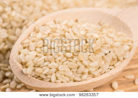 Organic Natural Sesame Seeds In The Wooden Spoon On Wood Table