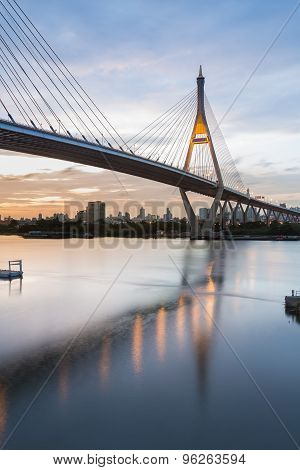Twilight of City highway curved and Suspension bridge