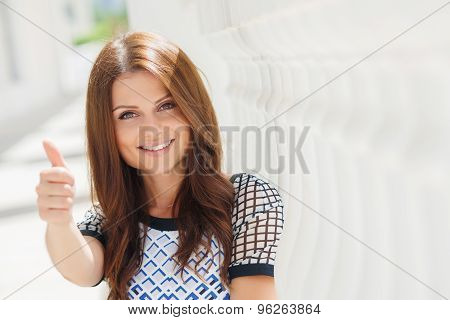 Cute smiling beautiful woman on the white terrace