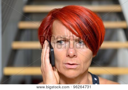 Serious Redhead Woman Calling Someone On Phone
