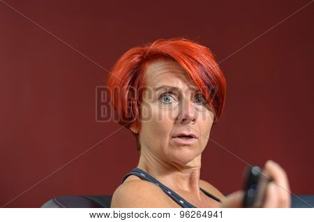Shocked Adult Redhead Woman Looking At The Camera