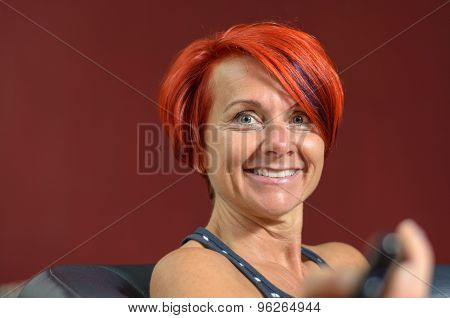 Happy Middle Aged Redhead Woman Smiles At Camera