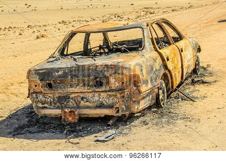 Abandoned burned car