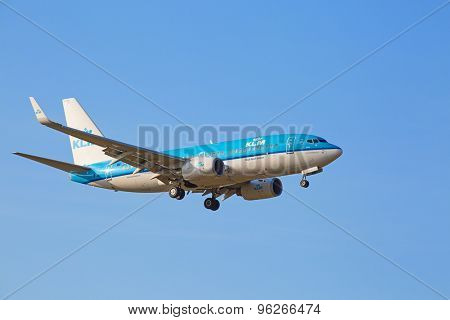 ZURICH - JULY 18: KLM Boeing-737 landing in Zurich airport after short haul flight on July 18, 2015 in Zurich, Switzerland. Zurich airport is home for Swiss Air and one of the biggest European hubs.