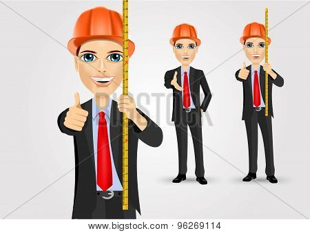 male engineer with holding tape measure
