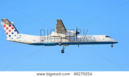 ZURICH - JULY 18: Croatian Bombardier Q400 landing in Zurich after short haul flight on July 18, 2015 in Zurich, Switzerland. Zurich airport is home for Swiss Air and one of the biggest European hubs.