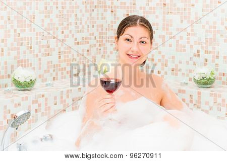 Romantic Girl With A Glass Of Wine In The Jacuzzi With Foam