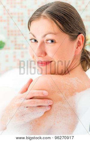 Vertical Portrait Of A Girl Taking A Bath With Foam