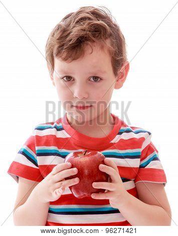 Little boy in striped t-shirt holding