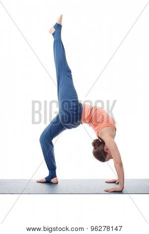 Beautiful sporty fit yogini woman practices yoga asana eka pada chakrasana (or eka pada urdva dhanurasana)  - one-legged wheel pose (or one-legged upward facing bow) pose isolated on white