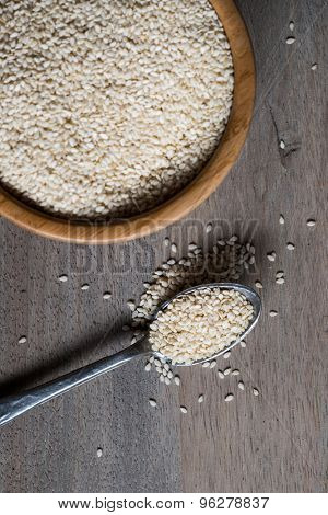Raw Organic Sesame Seeds in a Bowl over wooden background