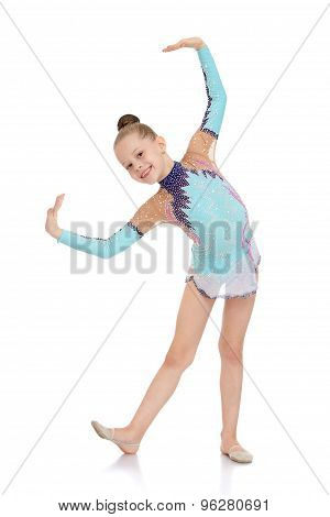 Beautiful young gymnast in a bright tracksuit