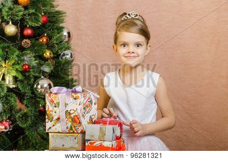 Five-year Girl With Christmas Gifts At The Christmas Tree
