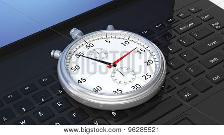 Silver chronometer on black laptop keyboard