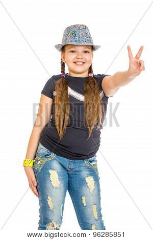 Cheerful girl schoolgirl in a hat