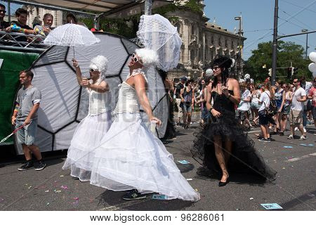 Munich, Germany - 11 July 2015: Christopher Street Day - Men In Black And White Bridal Dresses