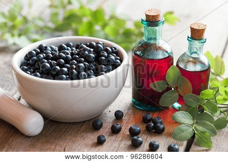 Mortar With Blueberries And Small Bottles Of Tincture Or Cosmetic Product.